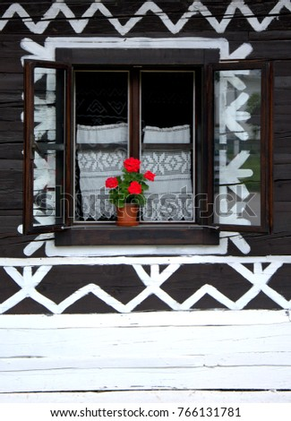 window on a wooden house