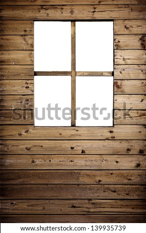 window on aged wooden wall