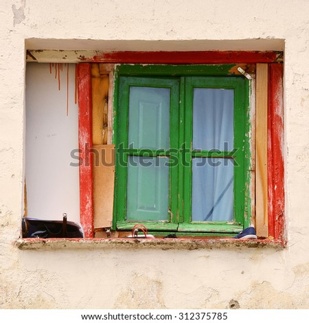 Window on facade of old house in Madrid - stock photo