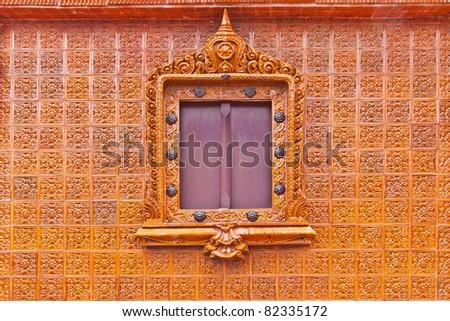 Window on glazed tile background, Thailand temple - stock photo