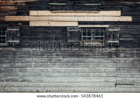 Window on old wooden wall texture. The horizontal slats of wood for the walls  the house