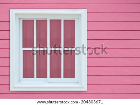 Window on pink wooden wall. - stock photo