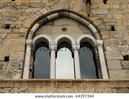 window on the facade of san fruttuoso abbey - stock photo