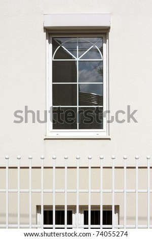 window on the white  wall - stock photo