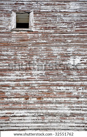 window on thr old painted house wall - stock photo