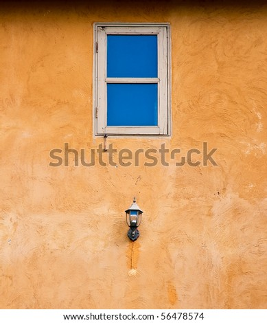 Window on vintage texture wall with lamp, Italian style - stock photo