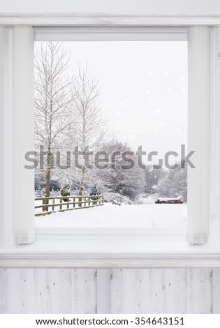 Window overlooking snowy country lane - stock photo