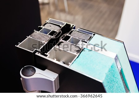 Window profile cut of with metal, glass and insulation - stock photo