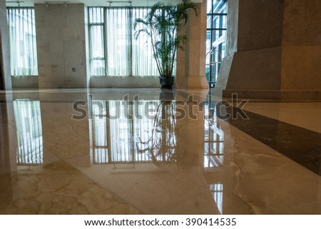 window reflection on marble floor in a glass building - stock photo