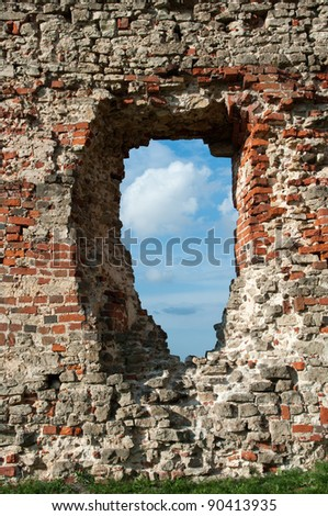 Window, ruins of medieval castle of the  Livonia crusades in Latvia - stock photo