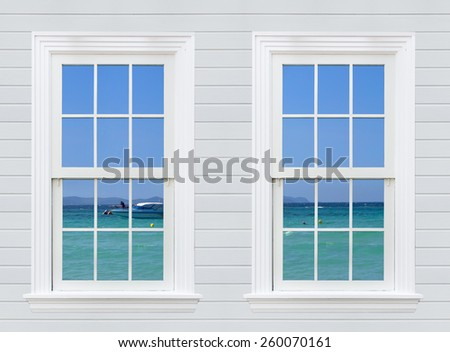 Window seascape view from wooden window and wall - stock photo