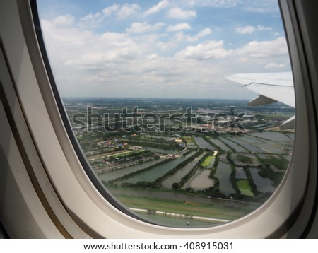window seat on a plane with city view - stock photo