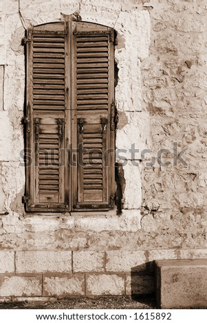 Window shutters and an old building in Antibes, France.