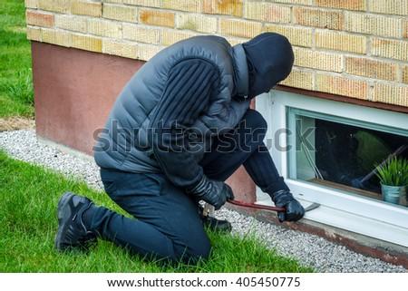 Window side house burglary - stock photo