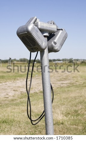 Window speakers from a drive-in movie screen. - stock photo