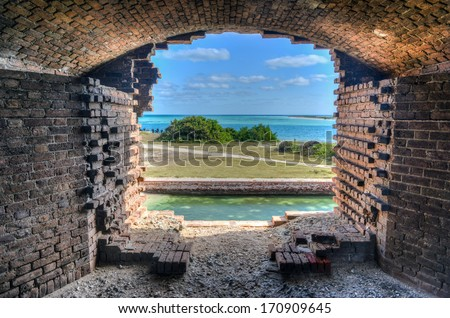Window to the ocean at Fort Jefferson at the Dry Tortugas National Park outside Key West, Florida. Fort Jefferson was built to protect one of the most strategic deepwater anchorages in North America. - stock photo