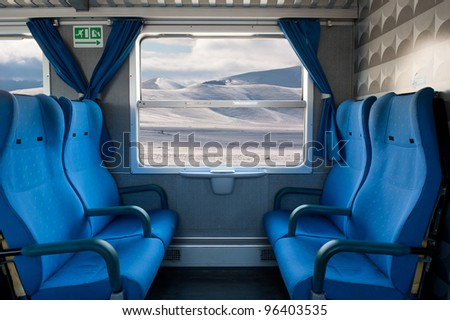 Window train with snow landscape and empty seats. - stock photo