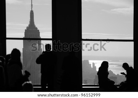 Window view of New York City Manhattan skyline with empire state building - stock photo