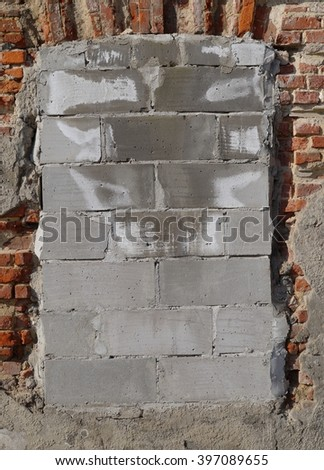 window walled gray bricks in the old house - stock photo