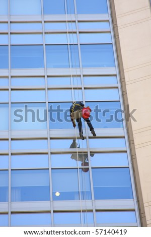 Window washer working on a row of windows