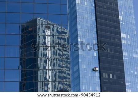 Window washers at work - stock photo