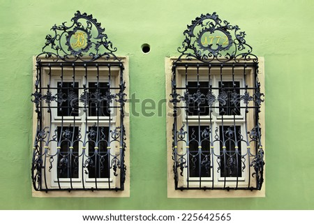 Window with a beautiful curved black metal lattice,  Rothenburg ob der Tauber, Germany - stock photo