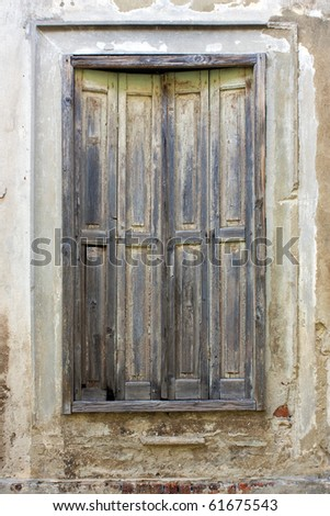 Window with aged shutters on old house in Croatia - stock photo