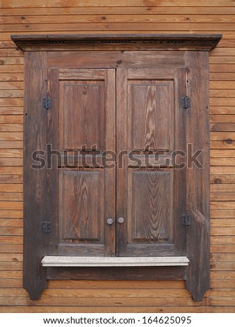 window with closed shutters - stock photo