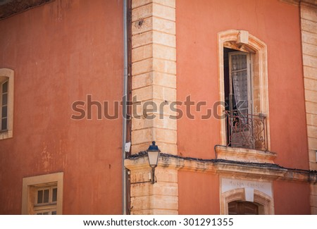 Window with coloured shutter in a small village in Provence, France