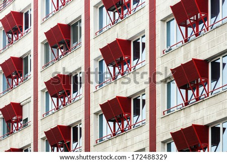 window with elements to hide air conditioners - stock photo
