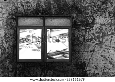 window with fence on scratched steel plate with blur banknote concept