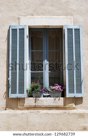 Window with flowers, Lourmarin village, Vaucluse, Provence, France - stock photo