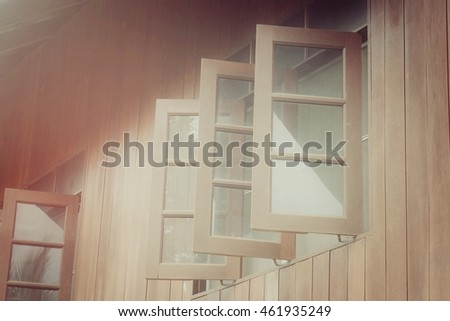 Window with glass of wooden home, process vintage tone