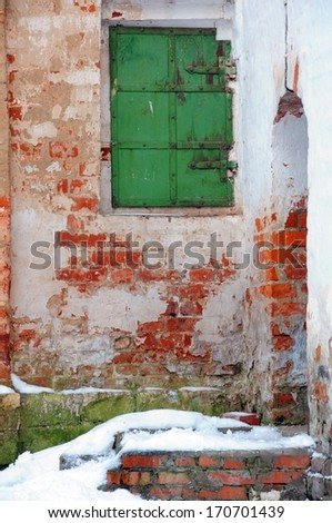 Window with green shutters in the abandoned convent in Central Russia - stock photo