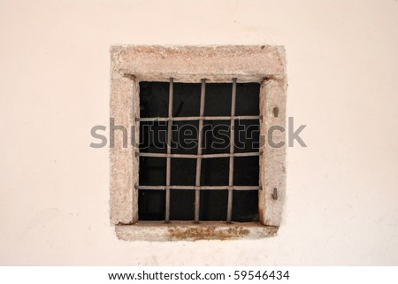 window with iron bars for protection and plant cyclamen - stock photo