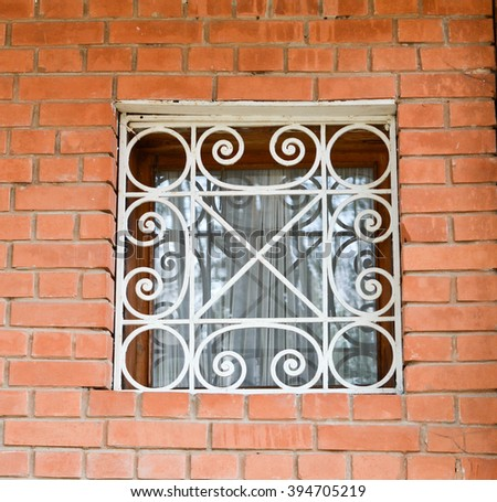 Window with metal fence