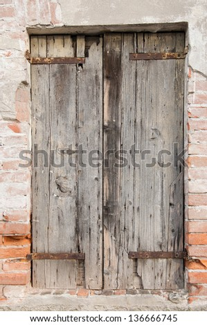 window with old doors - stock photo