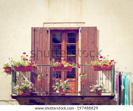 Window with Open Wooden Shutters, Decorated with Fresh Flowers, Retro Effect - stock photo