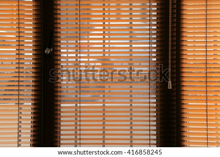 Window with orange jalousie, open. (Behind the window is a Street view.)  - stock photo