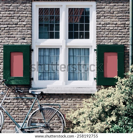 Window with Red Shutters in the Dutch City, Vintage Style Toned Picture - stock photo