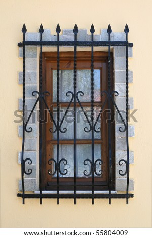 window with security bars - stock photo