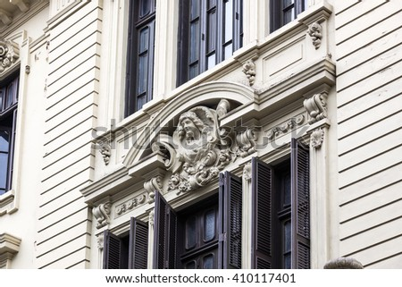 window with shutters in old building - stock photo