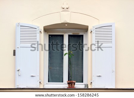 Window with shutters of old buildings on Montmartre, Paris.