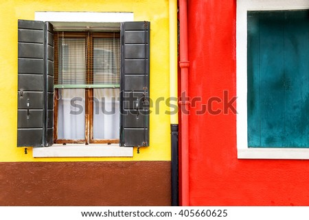 Window with shutters open on a yellow and red wall background.  Copy space. Empty place for you massege.  - stock photo