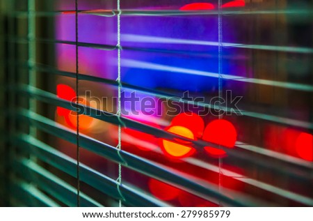 window with the background of the night city (police lights) - stock photo