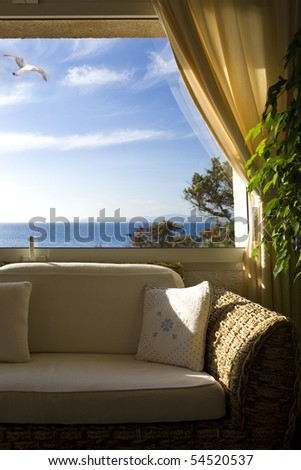 Window with view of the sea - stock photo