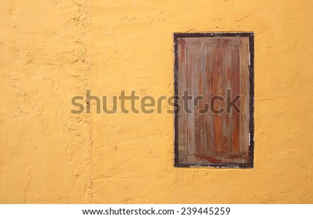 window with yellow wall background - stock photo