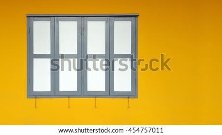 Window with yellow walls - stock photo