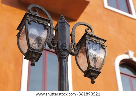 Windows and a street light, Venetian style.