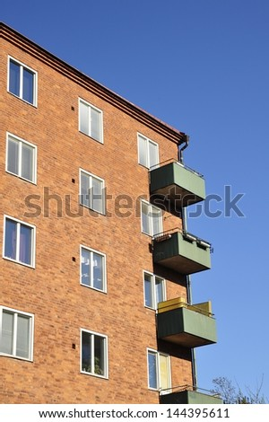 Windows and balconies against a blue sky in Stockholm, Sweden.